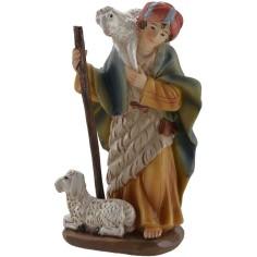 Pastore con pecora a spalle...