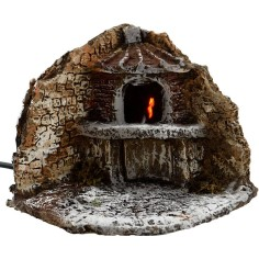 World Nativity Angle with the oven with a fire on cm 11,5x13x12 h.