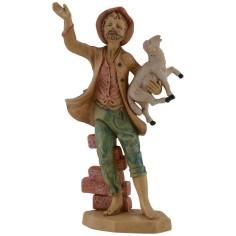 Uomo seduto al muretto con agnello in braccio serie lux cm 16