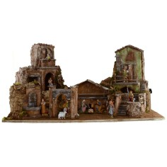 Full illuminated presepe of Landi statues with houses and