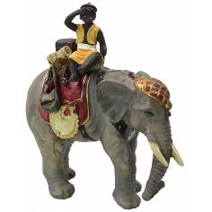 Boy on elephant series 12 cm in resin