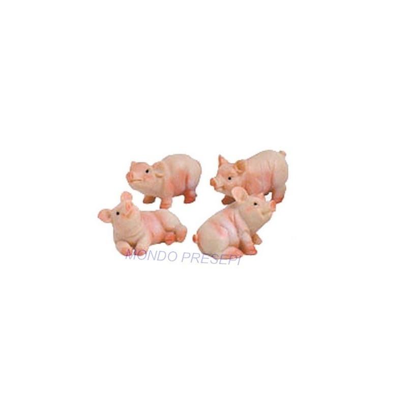 Set of 4 pigs in resin 3.5 cm