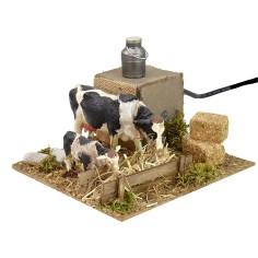 Mucche in movimento alla mangiatoia cm 15x15,5x10 h