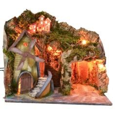 Paesaggio illuminato con grotta e mulino funzionante a corrente