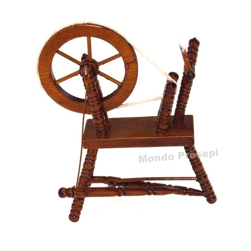 Painted wooden spinning wheel 6,5x9 h.