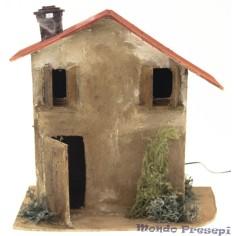 casa in legno effetto fumo