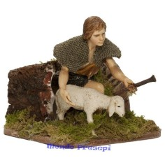 Boy stroking the 12 cm sheep in motion