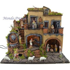 The crib with the village lit up with a fountain and oven 50x35