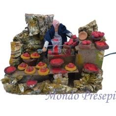 Mondo Presepi Donna che spreme i pomodori Lux in movimento cm 12