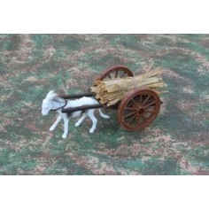 Straw wagon with donkey being towed