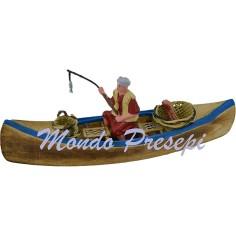 Barca in legno con pescatore