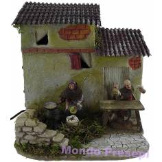 Casa con lavandaia e pifferaio in movimento Landi